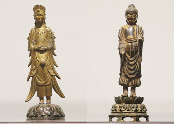 This composite file photo shows the Gilt-bronze Standing Bodhisattva, left, and the Gilt-bronze Standing Buddha, two high-value ancient statues previously owned by the Kansong Art and Culture Foundation that failed to win any bids at an auction held in July. The state-run National Museum of Korea recently purchased the two rare Buddhist treasures. [K AUCTION]