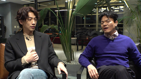 Singer Rain, left, and Park Jin-young discussing the theme of their music video ″Switch to Me″ in Rain's YouTube channel ″Season B Season.″ [YOUTUBE CAPTURE]