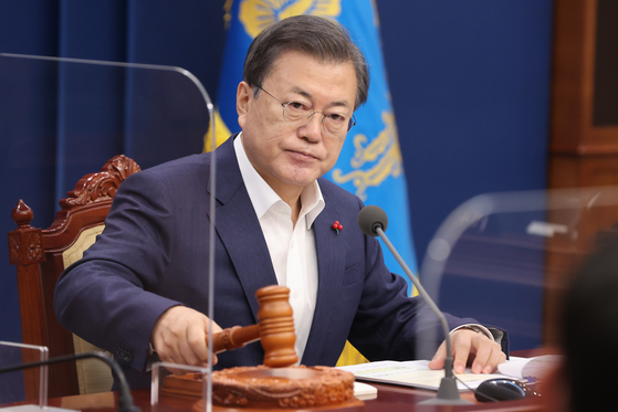 President Moon Jae-in declares the opening of a cabinet meeting on Tuesday at the Blue House.  [YONHAP]