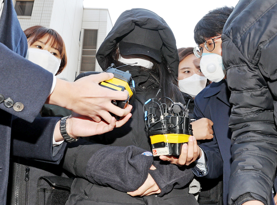 Jeong-in's adopted mother leaves the Seoul Southern District Court after a detention warrant hearing on Nov. 11, 2020. [YONHAP]