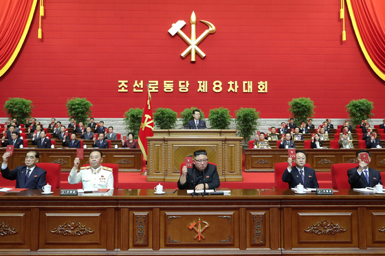 North Korean leader Kim Jong-un, center, and top party officials sit at a leadership podium to mark the opening of the 8th Congress of the ruling Workers' Party on Tuesday. [NEWS1]