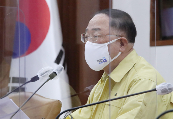 Finance Minister Hong Nam-ki attending the government meeting in Seoul on Wednesday. [YONHAP]