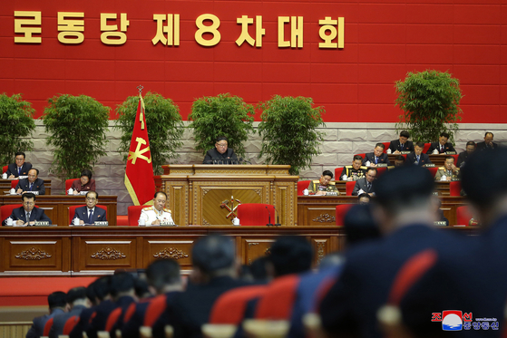 North Korean leader Kim Jong-un delivers a speech at the second day of the 8th Party Congress on Wednesday, as shown in this state media photograph. [YONHAP]