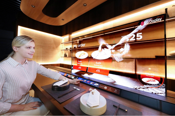 A transparent OLED manufactured by LG Electronics is placed at a sushi bar. [LG ELECTRONICS]