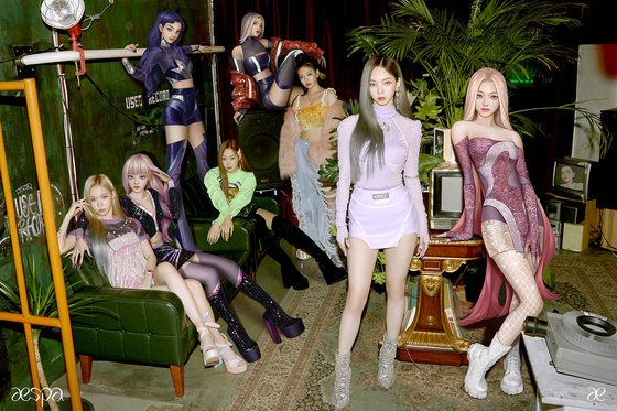 An image of girl group aespa, featuring all members, including the avatars. [SM ENTERTAINMENT]
