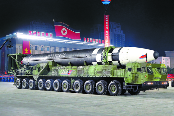 A new form of an intercontinental ballistic missile shown off on an 11-axle launcher by North Korea during a military parade in October. Kim mentioned the missile among several other new weapons as examples of some of the newest additions to the regime's arsenal aimed at deterring foreign aggression. [NEWS1]