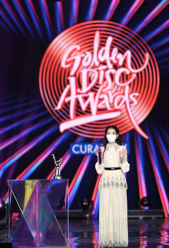 Singer-songwriter IU prepares to sing an encore after winning the Grand Prize in the Digital Song category of the 35th Golden Disc Awards. The awards ceremony was held at Kintex in Goyang, Gyeonggi, Saturday evening.