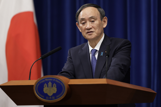 Japan's Prime Minister Yoshihide Suga speaks during a news conference at the prime minister's residence in Tokyo last week. [AP/YONHAP]