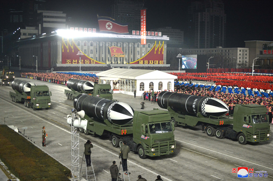 New submarine-launched ballistic missiles, called the Pukkuksong-5, are unveiled at a military parade in Pyongyang Thursday night to mark the close of the Eighth Workers' Party Congress, according to this state media photograph. [YONHAP]