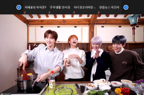 "Members of boy band Cravity take part in a preview of Airbnb's new online program ""Inside K-Pop,"" where stars will meet with fans online while enjoying a variety of activities such as cooking, dancing and singing. [AIRBNB]"