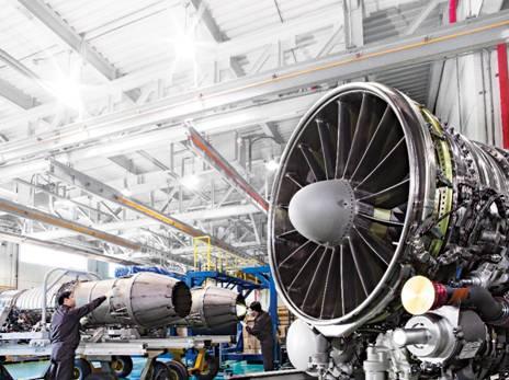 A Hanwha Aerospace engineer tests an airplane engine component. [HANWHA AEROSPACE]