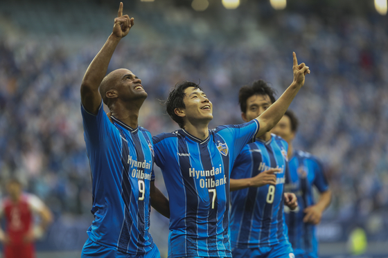 Ulsan Hyundai FC's Junior Negrao, left, and Kim In-Sung celebrate after a goal against Persepolis during the AFC Champions League final in Al Wakrah, Qatar on Dec. 19. (AP/YONHAP)