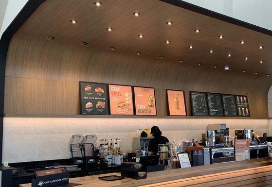Posco's wooden color printed PosMAC is installed in various Starbucks stores. [POSCO]
