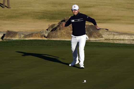 Kim Si-woo reacts after making a birdie putt on the 17th hole during the final round of The American Express tournament in La Quinta, California, on Sunday. [AP/YONHAP]