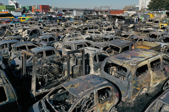 Scores of vehicles are burnt in a yard of a company that exports used cars in Incheon on Tuesday. [YONHAP]