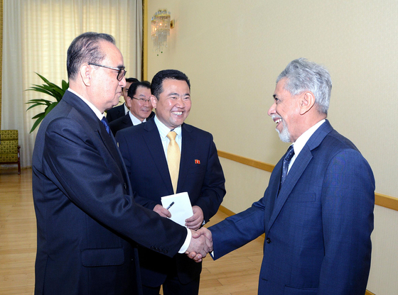 Ryu Hyun-woo, North Korea's former acting ambassador to Kuwait, is pictured at center in this state media photograph, accompanying North Korea's foreign minister at the time, Ri Su-yong, left, in a meeting with Omani envoys in Pyongyang in 2015. [YONHAP]
