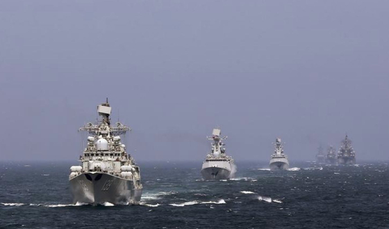 Chinese warships conduct a naval exercise with Russia in 2014. [CHINESE DEFENSE MINISTRY]