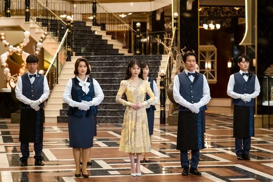A scene from tvN's hit drama series ″Hotel Del Luna,″ featuring IU, center. [TVN]