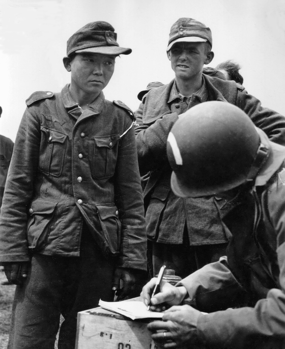 An Asian soldier captured in Normandy by the allied forces during WWII. The man is thought to be Yang Kyoung-jong. [PUBLIC DOMAIN]