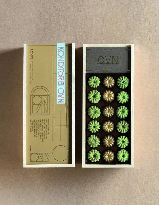 Two different flavors of canelés in a gift box available from Konditorei Oven in Hannam-dong, central Seoul. [KONDITOREI OVEN]
