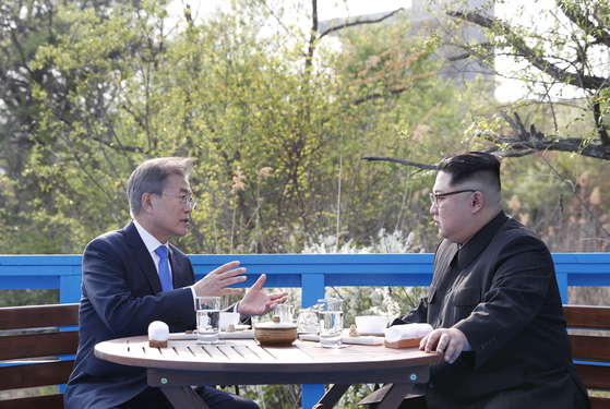 In this file photo, President Moon Jae-in, left, talks to North Korean leader Kim Jong-un in a one-on-one dialogue as part of the inter-Korean summit in Panmunjom on April 27, 2018.