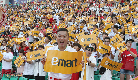 An SK Wyverns cheerleader holds an Emart sign during a collaboration event on July 13, 2019. [SK WYVERNS]