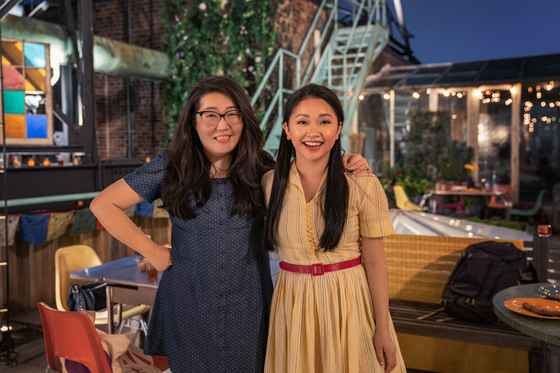 Original writer Jenny Han, left, and Lana Condor on the set of the film. [NETFLIX]