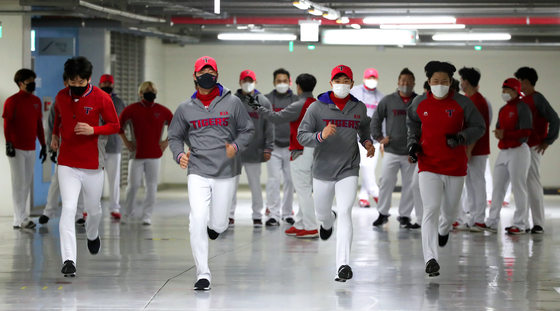 The Kia Tigers started their spring training avoiding the rain by warming up in the basement parking lot at Gwangju-Kia Champions Field in Gwangju. [YONHAP]
