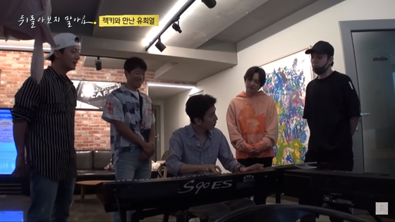 A captured image of Sechs Kies members and Yoo Hee-yeol, center, as they work on an upcoming track. [SCREEN CAPTURE]