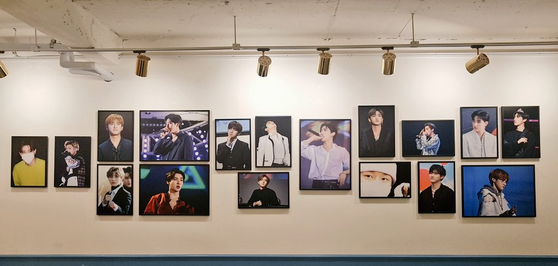A cafe is decorated with pictures of K-pop stars. [SCREEN CAPTURE]