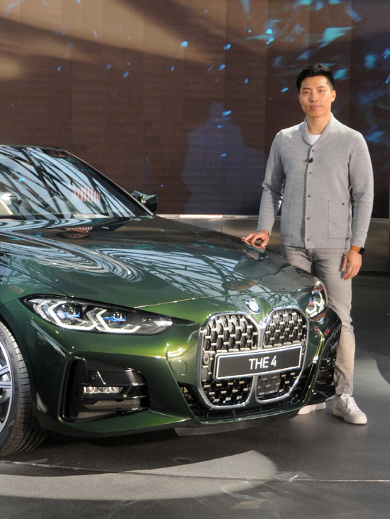 BMW Group's exterior designer Lim Seung-mo poses with the new 4 Series which he designed. [BMW KOREA]