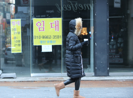 A store in Myeong-dong, central Seoul, is shown vacated on Jan. 29. Many stores in one of the most popular tourism districts were forced to close as the social distancing regulations implemented since late November continue. [YONHAP]