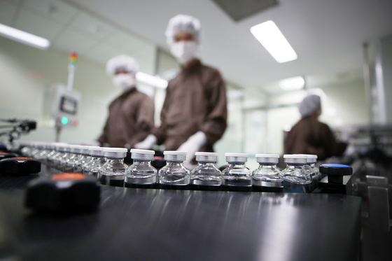 Celltrion's Covid-19 drug, which was approved by the government on Friday, coming off the production line at the company's plant in Incheon on Tuesday. [YONHAP]