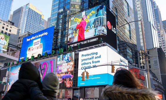 """Life in a Day,"" a YouTube documentary released last week featuring a series of short video clips from all over the world, is shown on the LG Electronics electronic display in Times Square in Manhattan, New York, on Monday. During an ad run during the documentary, LG Electronics said customers who own an LG OLED TV can watch the documentary in 4K resolution. [LG ELECTRONICS]"