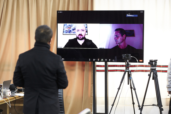 Park Myung-sung, producer at Seensee talks virtually to Tom Hodgson, right, international associate choreographer, and Simon Pollard, left, international associate director, about the show as they couldn't visit Seoul amid the coronavirus pandemic. [SEENSEE COMPANY]