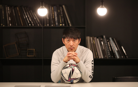 Kim Nam-il, manager of Seongnam FC, poses for a photo during an interview with the JoongAng Ilbo on Feb. 4. [JOONGANG ILBO]