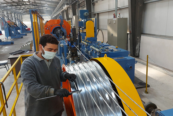 An employee produces cables at the Egyptian production subsidiary of LS Cable & System (LSMC). [LS]