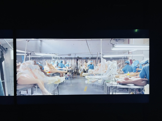 A captured image from Jung Yoon-suk's ″Tomorrow″ (2020) shows sex dolls at a manufacturing factory in China. [JOONGANG ILBO]