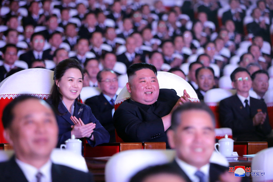 North Korea's state-run Korean Central News Agency released photos of North Korean leader Kim Jong-un and his wife, Ri Sol-ju, watching a performance on Tuesday in commemoration of the birthday of late leader Kim Jong-il. This is Ri's first public appearance in more than a year. [YONHAP]