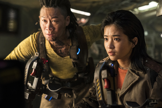 Tiger Park (played by Jin Sun-kyu), left, and Captain Jang (played by Kim Tae-ri) are immediately taken with Dorothy. [NETFLIX]
