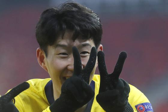 Tottenham Hotspur's Son Heung-min celebrates after scoring his side's first goal during the Europa League round of 32, first leg, match against Wolfsberger AC at the Puskas Arena stadium in Budapest, Hungary, on Thursday. [AP/YONHAP]