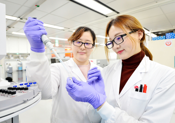 LG Chem researchers test the properties of newly-developed biodegradable materials. [LG Chem]