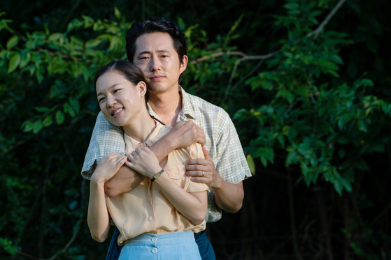 Actors Han Ye-ri, front, and Steven Yeun portray Monica and Jacob, Korean immigrants who arrive in the United States in the 1980s in hopes of finding the American dream in director Lee Isaac Chung's film ″Minari.″ [PAN CINEMA]