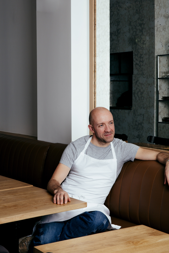 Chef Antonin Boneet of Michelin-starred restaurant Quinsou in Paris at his restaurant. He has decided to make Korean food to deliver to home diners during the times of the pandemic that kept many of the restaurants in Paris stayed closed. [VIRGINIE GARNIER]