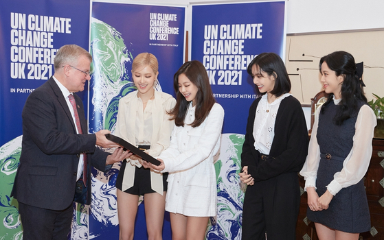 Blackpink receiving a letter from Simon Smith, the British ambassador to Korea, during a ceremony at the British Embassy in central Seoul. [YG ENTERTAINMENT]
