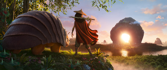 After losing her father, Raya spends her childhood roaming around the deserted lands in search of Sisu. with only her animal companion Tuk Tuk for company. [WALT DISNEY COMPANY KOREA]