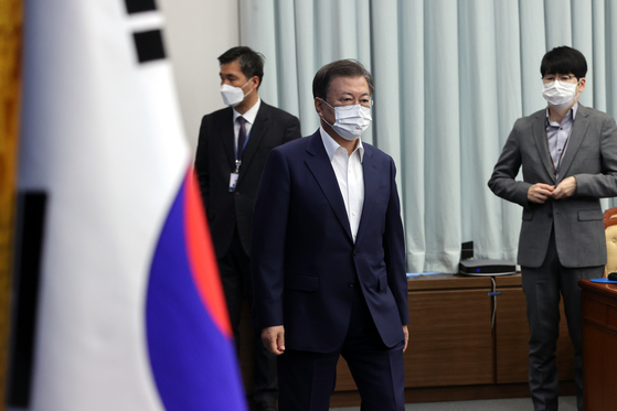 President Moon Jae-in attends a cabinet meeting at the Blue House where a 19.5 trillion won stimulus package was approved on Tuesday. [YONHAP]