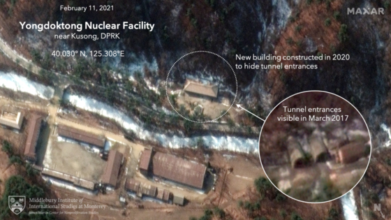 A satellite image taken on Feb. 11 by Maxar shows a new structure obscuring the entrance to a pair of tunnels at Yongdoktong in Kusong, North Pyongan Province, where nuclear weapons or nuclear weapon components are believed to be stored. [MIDDLEBURY INSTITUTE OF INTERNATIONAL STUDIES]