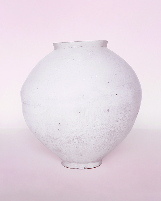 """""""BM04"""" (2006) by photographer Koo Bohnchang, a photo of the moon jar at the British Museum. [KOO BOHNCHANG]"""