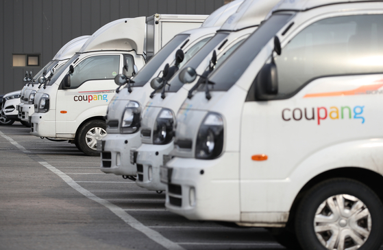 Coupang trucks are seen parked in a lot in Seocho District, southern Seoul, last month. [YONHAP]
